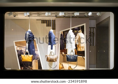boutique fashion display window in shop - stock photo