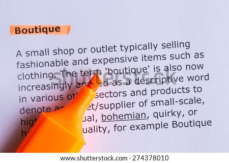 boutique word highlighted on the white paper