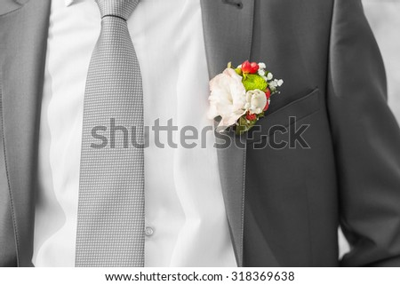 boutonniere on suit of groom on the wedding day - stock photo