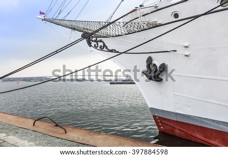 bow and bowsprit of an old sailing ship Gorch Fock - stock photo