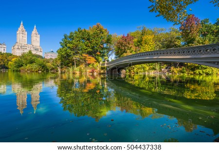 Bow bridge in Central park at Autumn sunny day, New York City