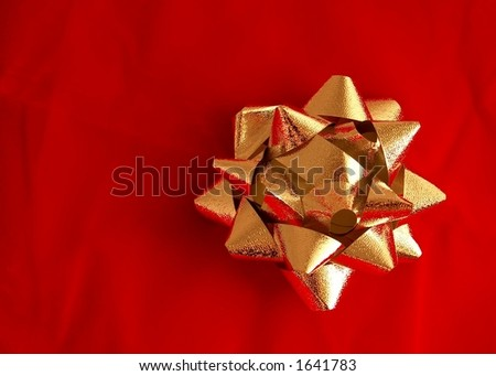 Bow - Gold on Red - stock photo