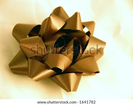 Bow - Gold on White - stock photo