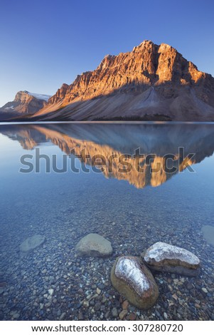 Bow Lake along the Icefields Parkway in Canada. Photographed at sunrise. - stock photo