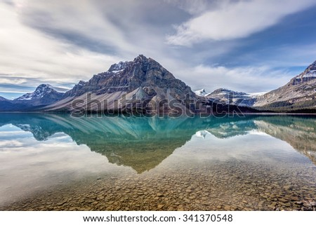 Bow Lake reflection from Num-Ti-Jah Lodge on the Icefield Parkway, Banff National Park, Alberta, Canada - stock photo