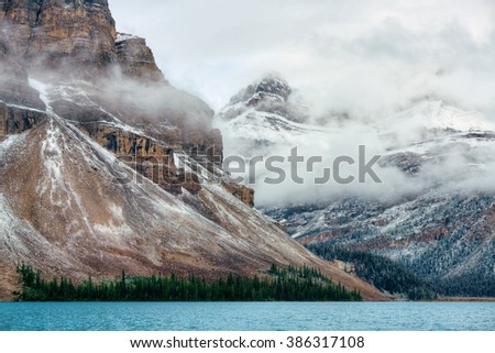 Bow Lake with snow and fog mountain in Banff National Park, Canada. - stock photo