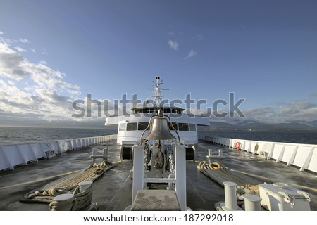 Bow of Ship Vessel with Bell at Sea - stock photo