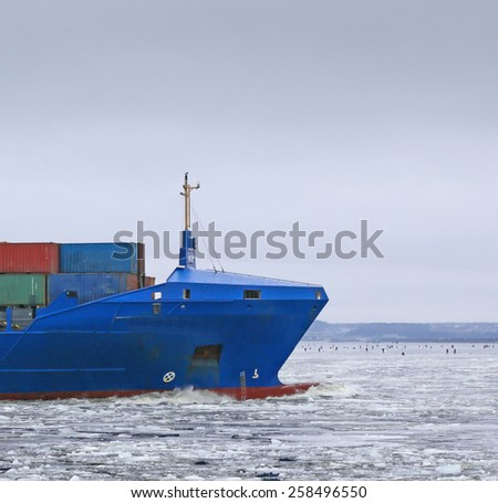 bow of the ship in motion through the ice - stock photo