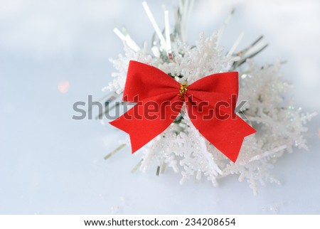 bow red snowflakes on a light background
