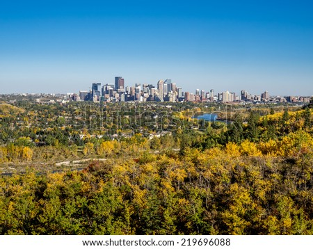 Bow river valley in Calgary, Alberta during autumn. Shot is taken in Edworthy Park. Urban centre visible in the distance. - stock photo