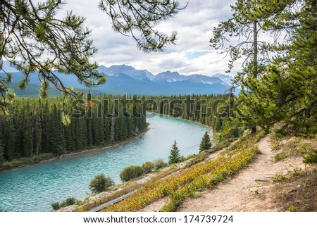 Bow River winding through Rocky Mountains, Banff National Park, Alberta, Canada. Copy space. - stock photo