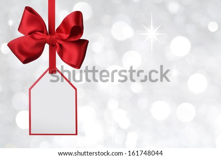 Bow with tag on abstract background - stock photo