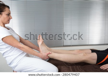 Bowen therapy - treatment of a man's leg