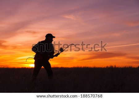 Bowhunter at Ready in Sunset