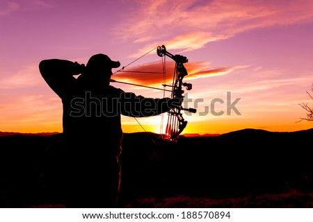 Bowhunter Silhouette at Sunrise - stock photo