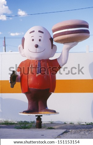 BOWIE, ARIZONA - CIRCA 1980's: Mascot for a hamburger stand, Bowie, AZ
