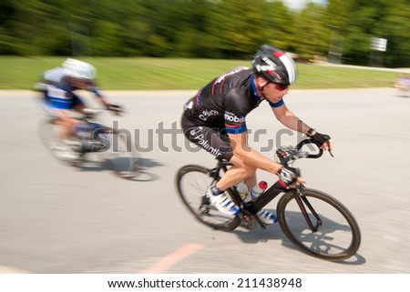BOWIE, MARYLAND - AUGUST 17: A cyclist competes in the elite men's race in the Dawg Days of Summer Circuit Race on August 17, 2014 in Bowie, Maryland