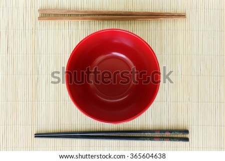 bowl and chopsticks on mat texture japanese an chinese life style tradition - stock photo
