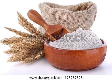Bowl and  scoop with flour made up of whole grain cereals - stock photo