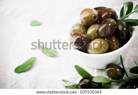 Bowl filled with fresh black olives served as an accompaniment or appetizing snack with copyspace - stock photo