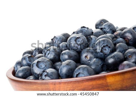 Bowl full of blueberries with white background
