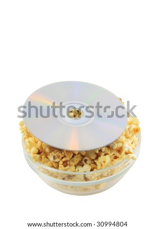 Bowl full of caramel popcorn with  DVD disk . Isolated - stock photo