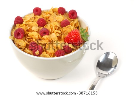 Bowl full of cereal with strawberry and raspberries on top