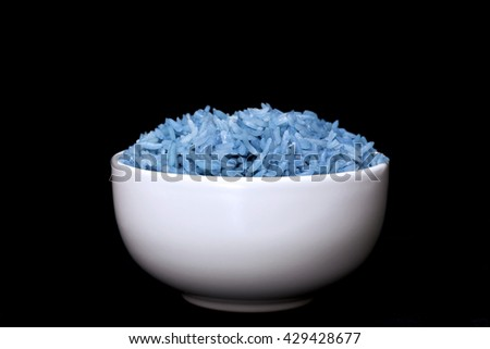 bowl full of herb rice isolated on black background