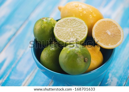 Bowl full of lemons and limes, horizontal shot