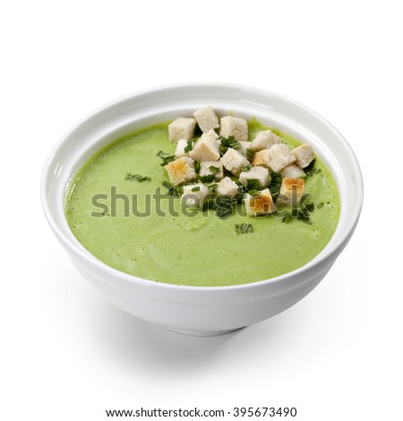 Bowl green soup puree with croutons on a white background - stock photo