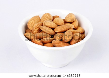 Bowl of almonds - stock photo