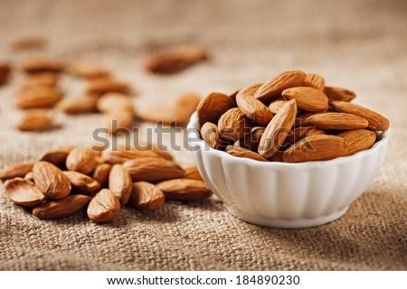 Bowl of Almonds on Burlap - stock photo