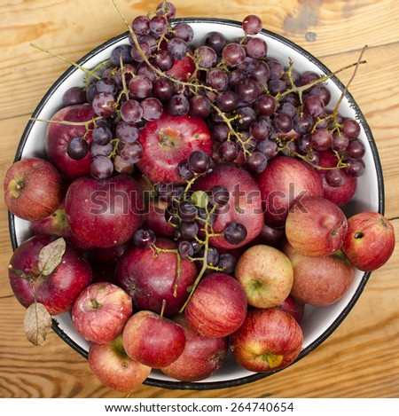 Bowl of apples and grapes - stock photo