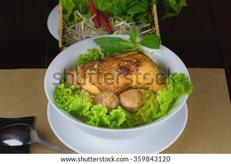 Bowl of Asian noodle soup with noodle, chicken leg, potato, vegetable...Kind of wonton soup - stock photo