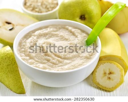 bowl of baby food, healthy breakfast porridge - stock photo