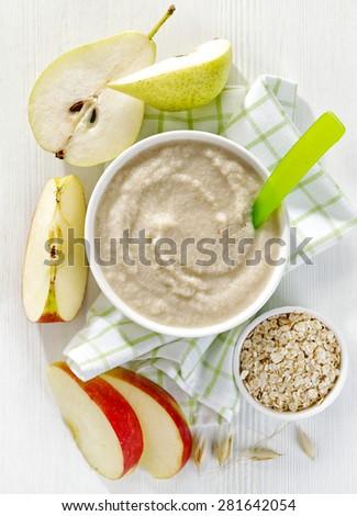 bowl of baby food, healthy breakfast porridge, top view - stock photo
