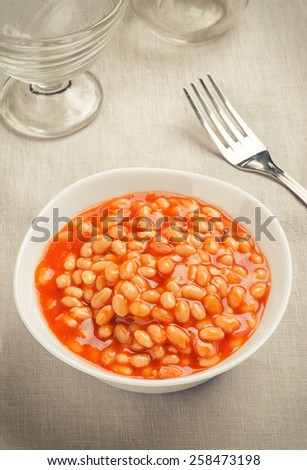 Bowl of baked beans in tomato sauce close up - stock photo