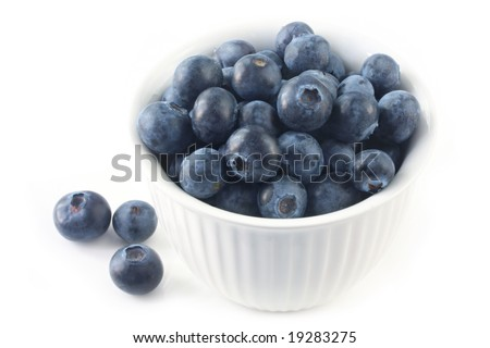 Bowl of blueberries, isolated on white.  Close-up view of this delicious berry fruit.
