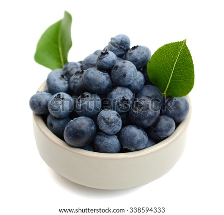 bowl of blueberries on white background