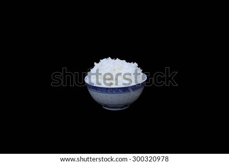 Bowl of boiled rice isolated in black background - stock photo