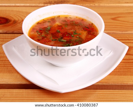 Bowl of Bright Red Creamy Tomato Soup with Yogurt