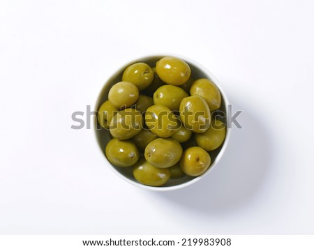 Bowl of brine cured green olives - stock photo