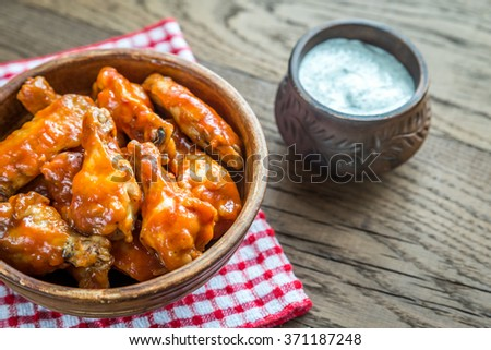 Bowl of buffalo chicken wings - stock photo