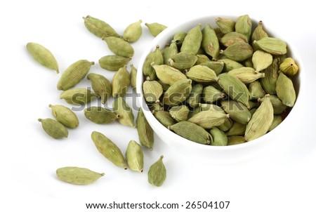 bowl of Cardamoms  on white background - stock photo