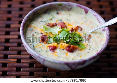 Bowl of Cauliflower Chowder with cheddar cheese, bacon and cilantro garnish - stock photo