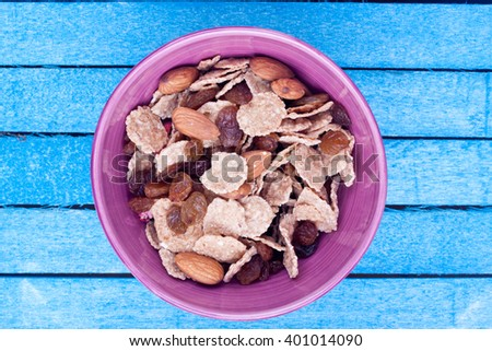 bowl of cereal with raisin and almond - stock photo