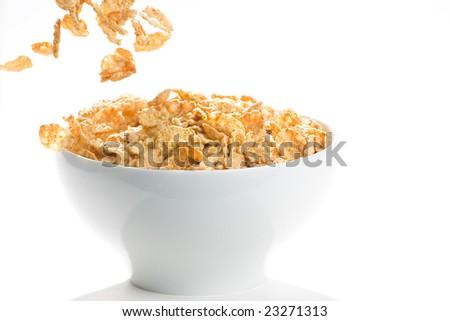 bowl of cereal with raisins, milk and orange juice - stock photo