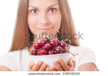 bowl of cherries in women's hands, isolated on white background