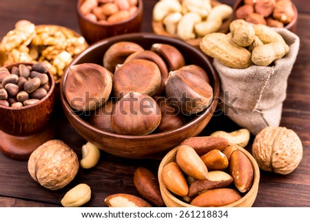 Bowl of chestnuts and other nuts - stock photo