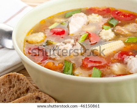bowl of chicken and vegetable soup - stock photo